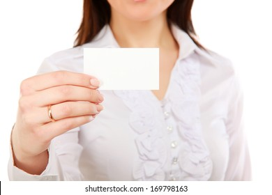 Portrait of a casual young woman holding blank card - on white background