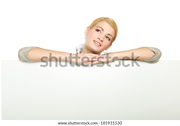 Portrait of a casual young woman near blank card - over white background.