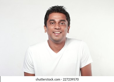 Portrait of a casually dressed smiling Indian young man