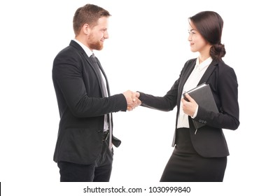 Portrait of Caucasian businessman and Asian businesswoman cooperating
