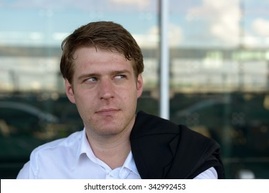 Portrait of Caucasian businessman looking up outdoors