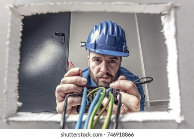 portrait of caucasian electrician at work