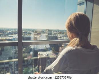 Portrait of Caucasian girl in business center.