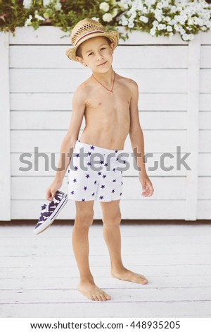 Portrait of caucasian happy baby (boy) in the straw hat near swimming pool. ce58f1a139f