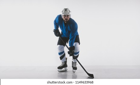 Portrait of Caucasian male ice hockey player in uniform posing against white background