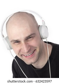 Portrait of a Caucasian man from shoulders listening to headphones isolated on white background