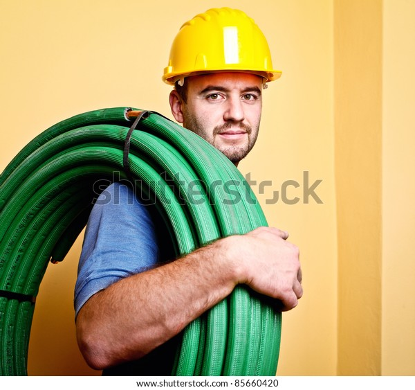 portrait of caucasian manual worker with pipe
