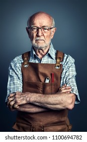 portrait of caucasian old carpenter studio shot