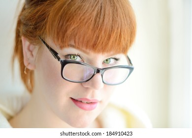 portrait of caucasian redhead girl with glasses