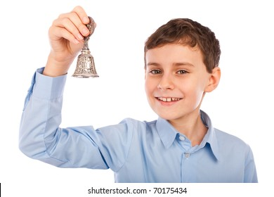 Portrait of a caucasian schoolboy ringing the bell for a course break
