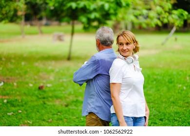 Portrait caucasian senior woman and old man, couple elder in love happy in park
