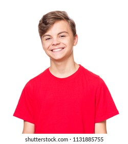 Portrait of caucasian smiling teen boy. Handsome teenager wearing red t-shirt, isolated on white background. Happy child looking at camera.