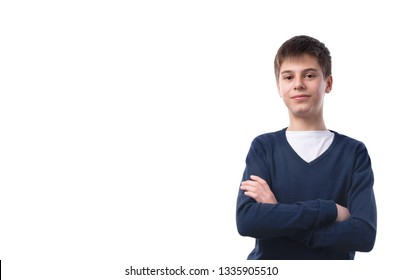 Portrait of caucasian teen boy on white background with folded arms. Handsome child looking at camera.