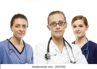 Portrait of Caucasian women medical healthcare workers in uniforms against white background.