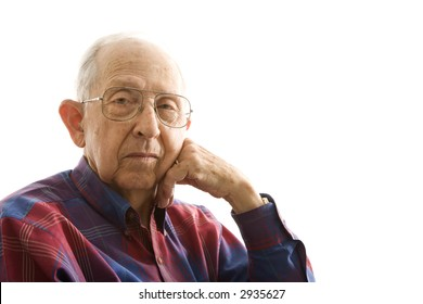 Portrait of Caucasion elderly man with face propped on hand.