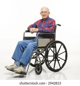 Portrait of Caucasion elderly man sitting in wheelchair smiling at viewer.