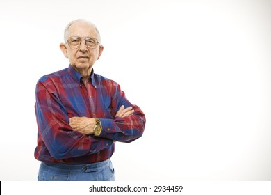 Portrait of Caucasion elderly man wearing plaid shirt and cowboy hat with arms crossed.
