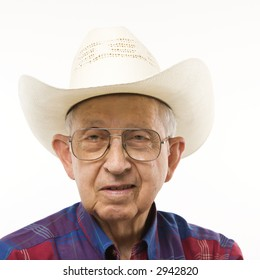 Portrait of Caucasion elderly man wearing plaid shirt and cowboy hat.