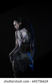 Portrait of a character for computer game Body painting skeleton cyborg, woman with pattern on body on black background