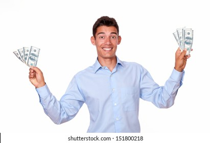 A portrait of a charismatic male on blue stylish shirt standing and holding money while smiling at you on isolated studio