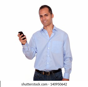 Portrait of a charming adult man calling on cellphone over white background