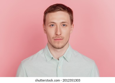 Portrait of charming appealing nice attractive guy look camera on pink background