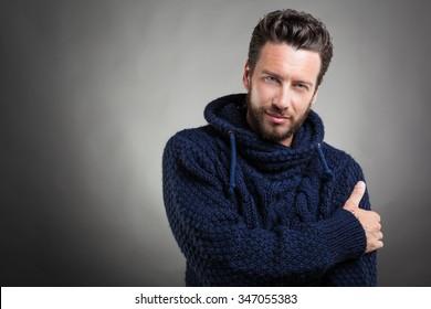 Portrait of Charming Bearded Man wearing blue sweater