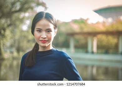Portrait charming beautiful Asia woman at garden park nuture background.