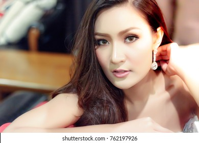 Portrait charming beautiful girl: Attractive woman has beautiful face and nice skin. Gorgeous girl is an Asian people. She looks something. A lovely woman feels relaxed and happy. She looks friendly