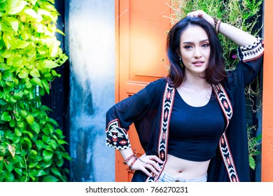 Portrait charming beautiful girl: Attractive woman looks so relaxed and happy. A gorgeous girl has beautiful face. A pretty girl has a nice smile with copy space