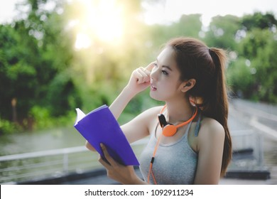 Portrait charming beautiful reader woman. Beautiful woman loves reading or learning. Gorgeous woman loves seeking knowledge. Pretty girl is imagining and thinking while she is reading book. copy space