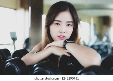 6aaed56fb3b Portrait charming beautiful woman. Attractive beautiful girl stay at gym.  Pretty woman get relaxed