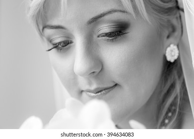 Portrait of a charming bride with beautiful smile and red lipstick