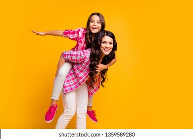 Portrait of charming careless mature little ladies stylish hairstyle satisfied have free time walk feel careless childish funny fool isolated dressed trendy checked cotton clothes vivid background
