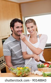 Portrait of a charming couple cooking in their kitchen
