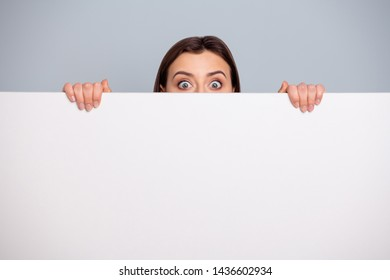 Portrait of charming cute funny funky cute lady astonished impressed have reaction hear horrible terrible unbelievable information isolated grey silver background