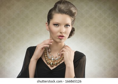 portrait of charming fashion lady posing with brown hair-style, elegant black dress and bright necklace