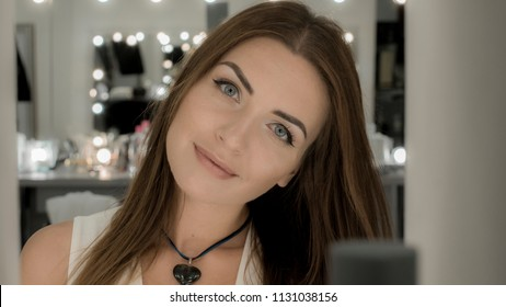 Portrait of charming girl with brown hair and professional makeup
