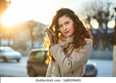 Portrait of a charming girl outdoors in a coat.