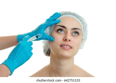 Portrait of charming girls in a special hat for the hair surgeon in blue gloves