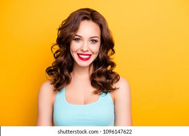 Portrait of charming joyful girl with modern hairdo red lipstick pomade tempting seductive decollete isolated on yellow background looking at camera