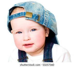 Portrait of the charming kid in a jeans cap