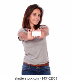 Portrait of a charming lady holding a business card of copyspace on white background