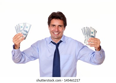 Portrait of a charming man smiling and showing you cash money against white background