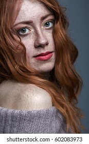Portrait of a charming redheaded freckled woman