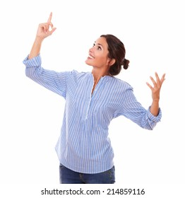 Portrait of charming woman looking and pointing right up with her finger and standing on isolated white background - copyspace