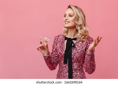 Portrait of charming woman in top with sequins. Lady holding martini glass