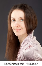 Portrait of a charming young brunette woman looking at camera