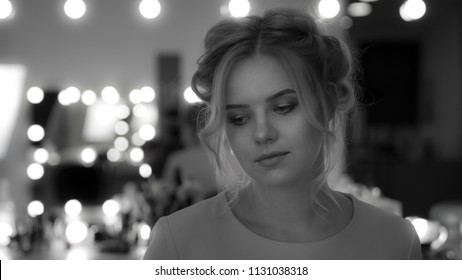 Portrait of charming young girl with professional makeup and hairstyle