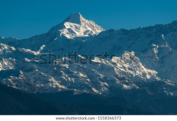 A portrait of the Chaukhamba peak and the glaciers below as seen from the Himalayan village of Chaukori in Uttarakhand, India.